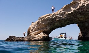 Tourists on the natural stone bridge at the sea caves outside Ayia Napa. Photograph: Alamy