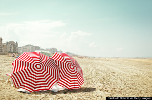 Red and white umbrella at beach