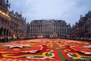 Night exposure of the beautiful Grand Place with the famous Flower Carpet surrounded by ornate buildings. Brussels, Belgium.