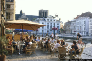 People in street cafes, Graslei, Gent, Flanders, Belgium, Europe