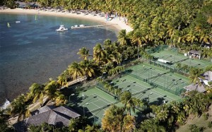 The four floodlit courts at Curtain Bluff are right by the beach